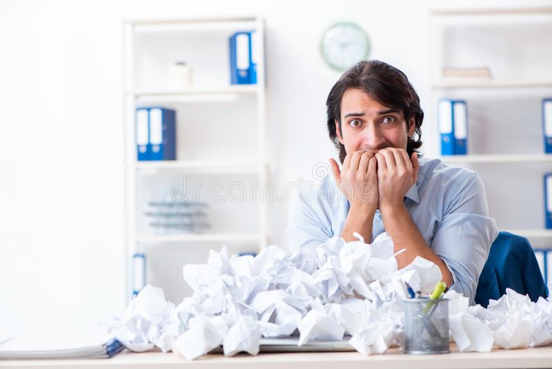 Businessman rejecting new ideas with lots of papers stock photo