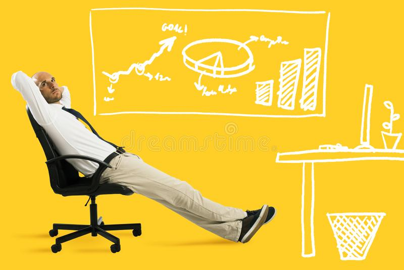 Businessman relax and think sitting on a chair. Yellow background stock photography