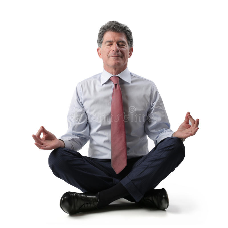 Businessman relaxing and doing yoga stock images