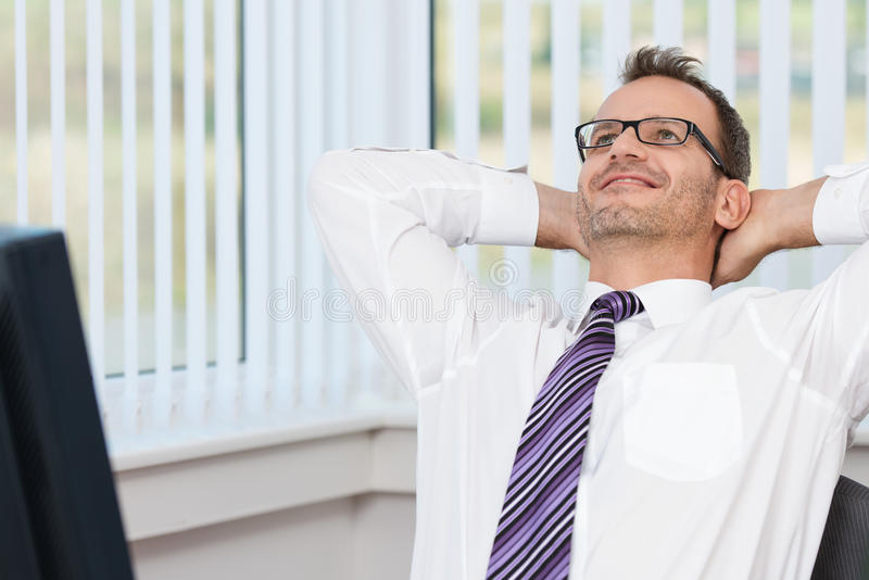 Download Businessman Relaxing At His Desk Stock Image - Image: 34293255