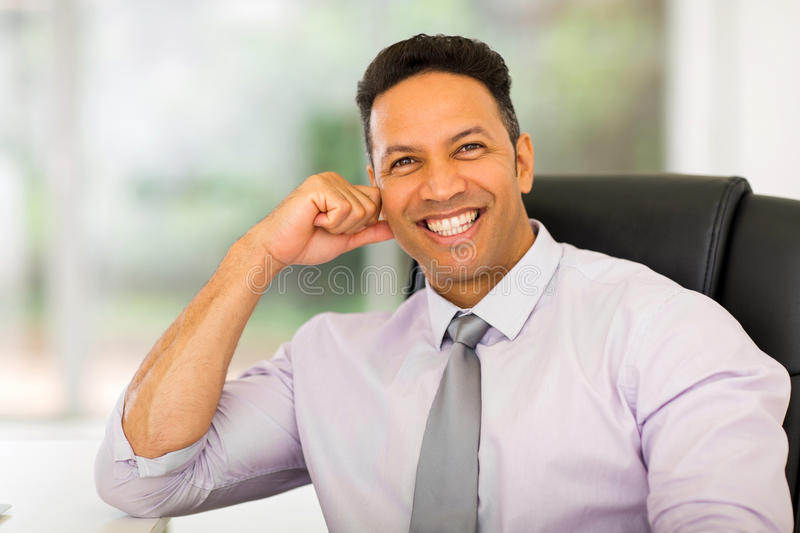 Businessman relaxing in office royalty free stock image