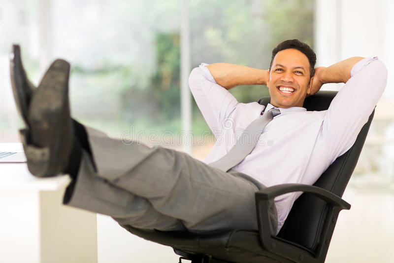 Businessman relaxing in office royalty free stock photo