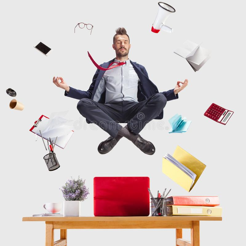 Businessman relaxing in office, while his work is doing royalty free stock photo