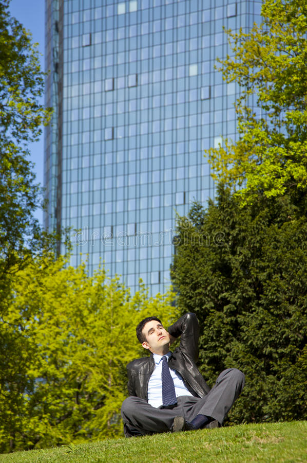 Download Businessman Relaxing In Park During Lunch Break Stock Photo - Image: 19258134