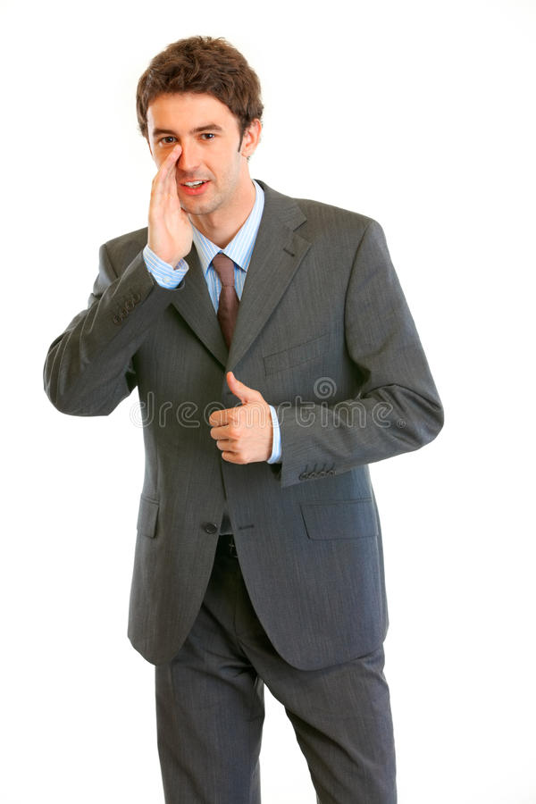 Businessman reporting news and showing thumbs up. Smiling modern businessman reporting good news and showing thumbs up gesture isolated on white royalty free stock images
