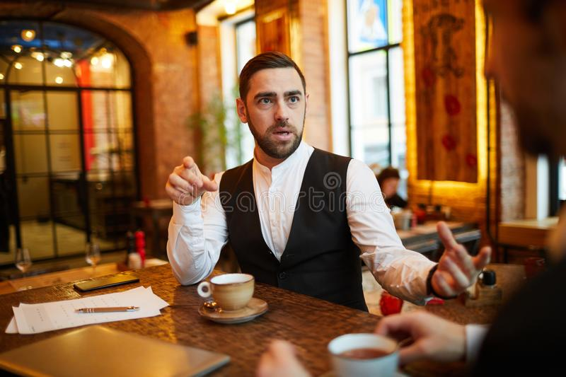 Businessman in Restaurant royalty free stock photography
