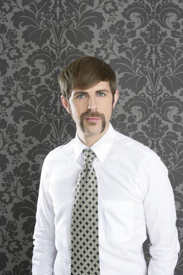 Businessman retro mustache over gray wallpaper royalty free stock photo