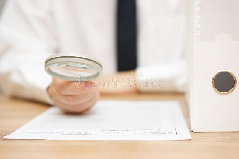 Businessman is reviewing company documentation. On workplace, due diligence concept stock images