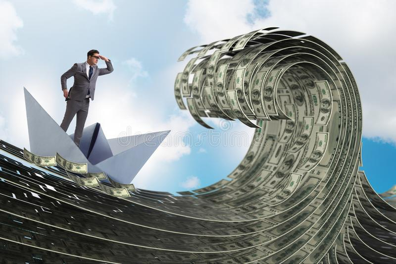 The businessman riding paper boat in dollar sea royalty free stock image