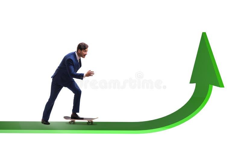 Businessman riding skateboard on financial graph stock photo
