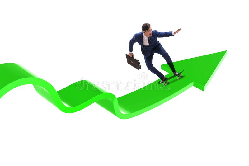 Businessman riding skateboard on financial graph stock images
