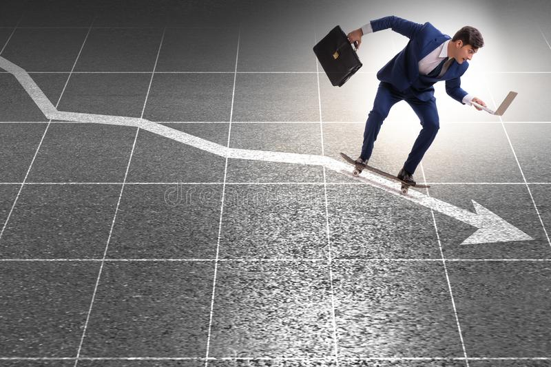 Businessman riding skateboard on financial graph. The businessman riding skateboard on financial graph royalty free stock image