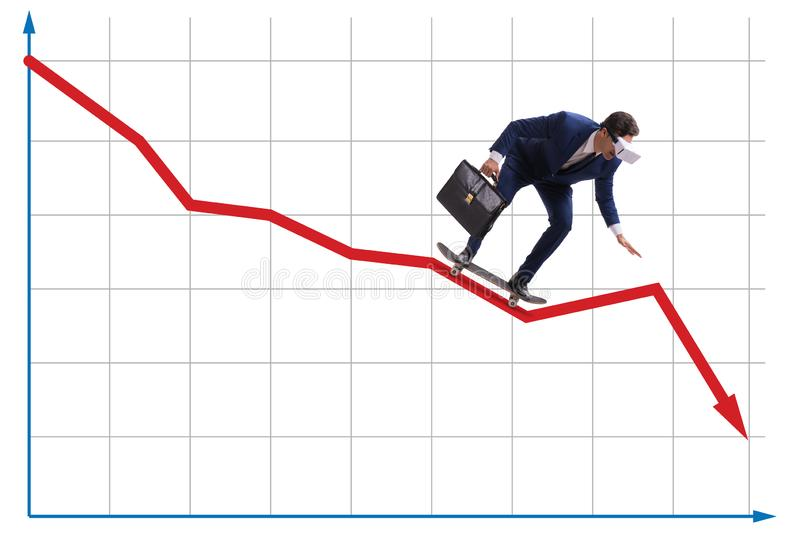 Businessman riding skateboard on financial graph. The businessman riding skateboard on financial graph royalty free stock photography