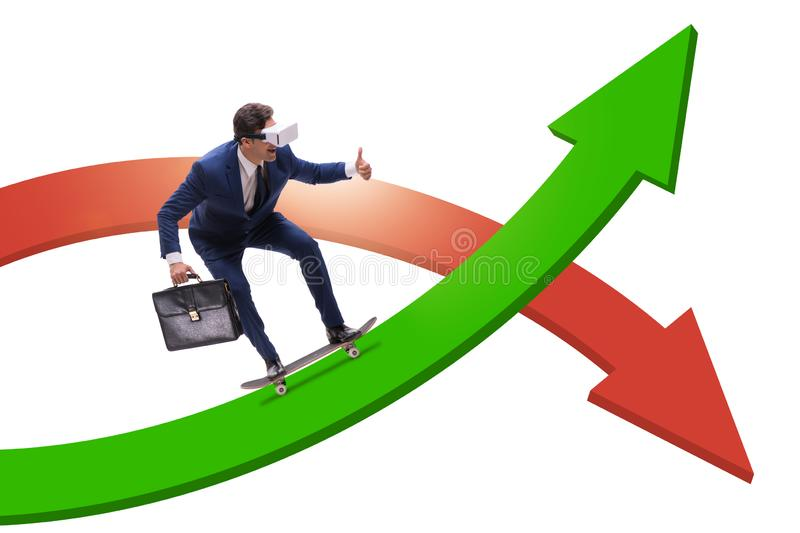 Businessman riding skateboard on financial graph. The businessman riding skateboard on financial graph stock photo