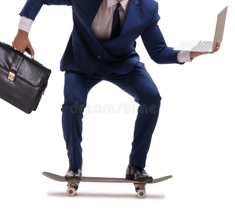 Businessman riding skateboard isolated on white background. The businessman riding skateboard isolated on white background stock photography