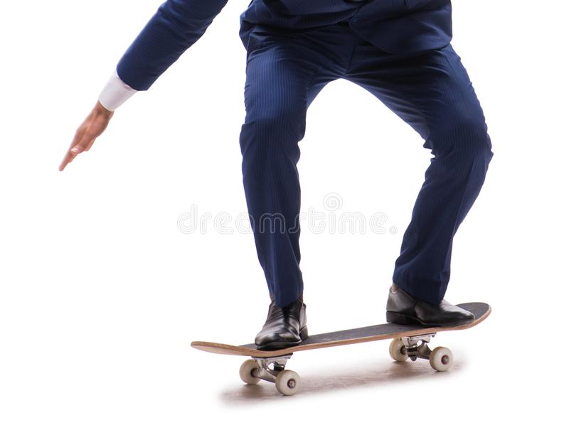 Businessman riding skateboard isolated on white background. The businessman riding skateboard isolated on white background royalty free stock photo