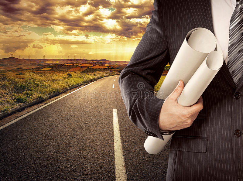 Businessman on the road stock image