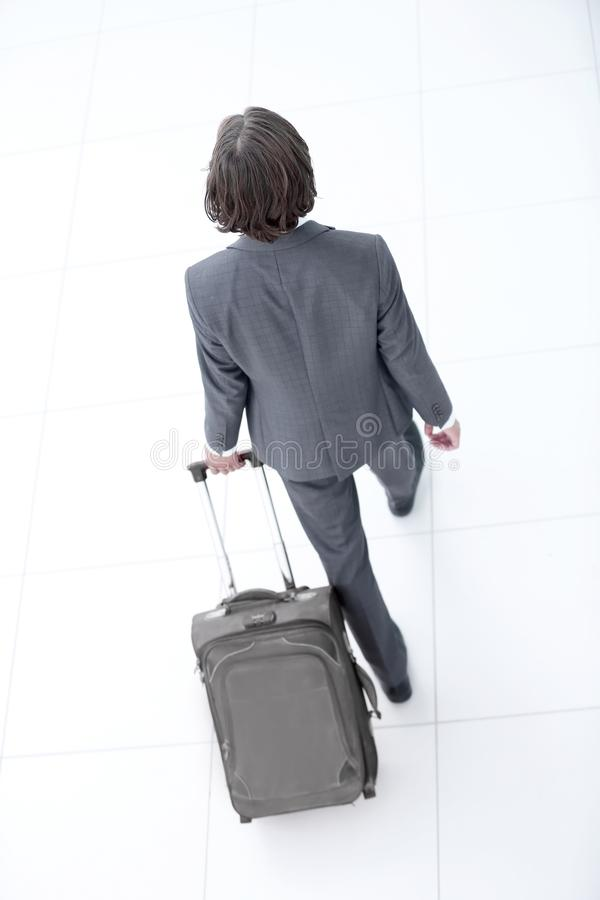 Businessman with a road suitcase.isolated on white. royalty free stock photography