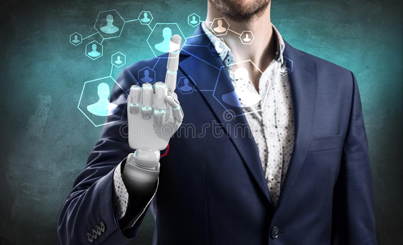 Businessman with robot hand touches icons. Businessman with robot hand touches icons over gray wall background royalty free stock photo