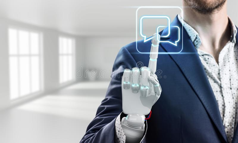 Businessman with robot hand touches virtual icon. 3d rendering. Businessman with robot hand touches virtual communication icon in bright white office. 3d stock image