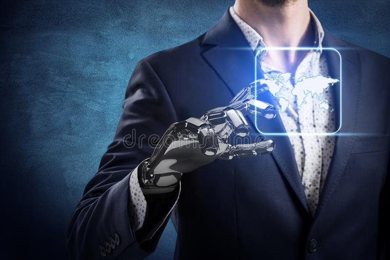 Businessman with robot hand touches world map icon. Businessman with robot hand touches world map icon over dark wall background. Elements of this image stock images