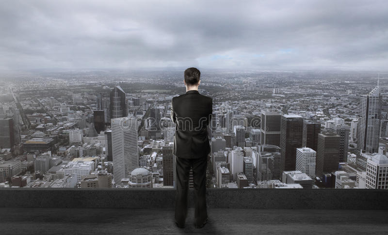 Businessman on roof royalty free stock photo