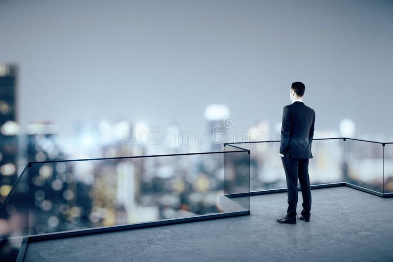Businessman on rooftop stock photo