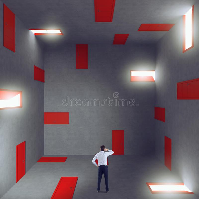 Businessman in a room full of doors. Concept of bureaucracy and stress stock image