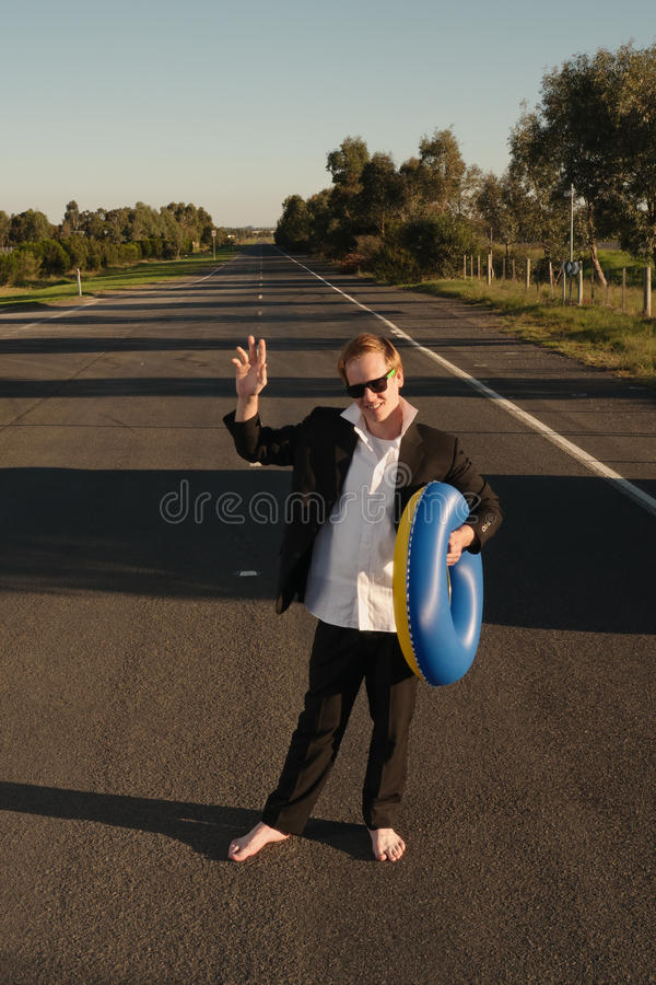Businessman with rubber ring waving stock image