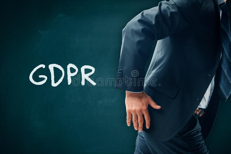 Businessman run away from GDPR royalty free stock photography