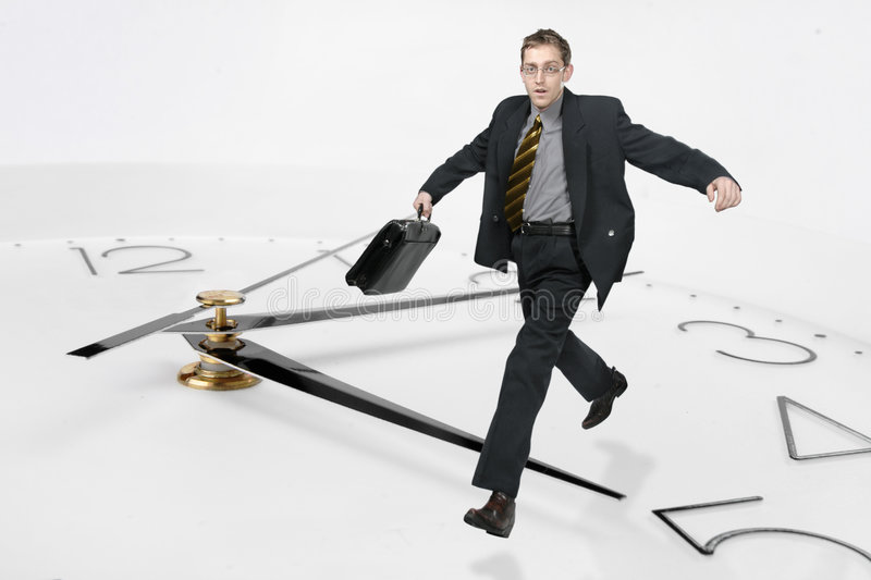 Businessman run through the ti royalty free stock photography