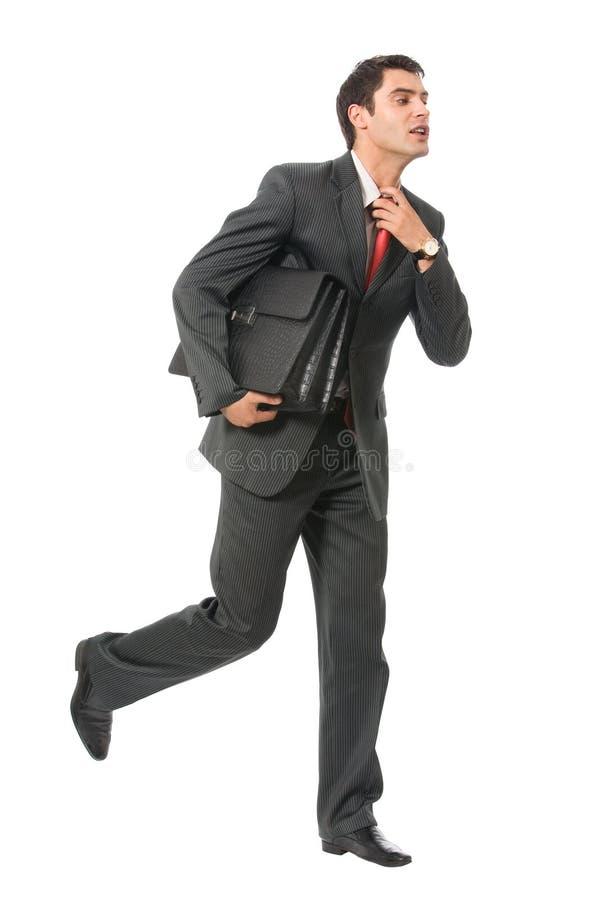 Businessman running royalty free stock image