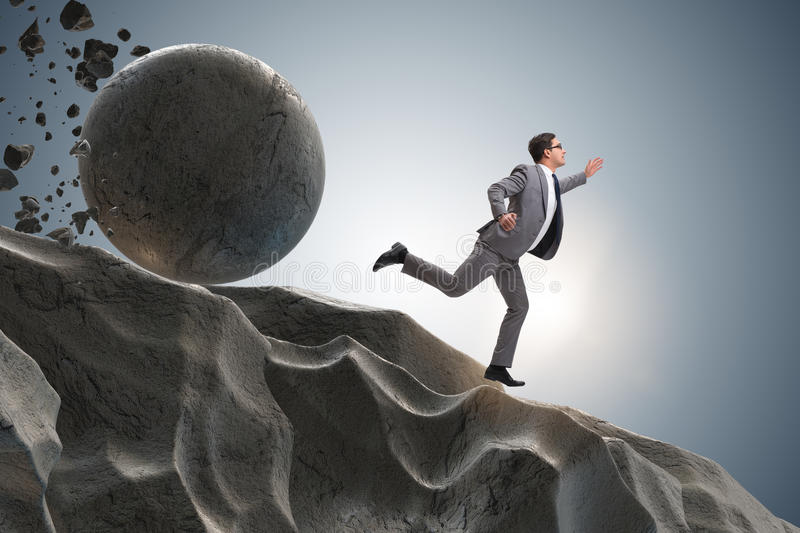 The businessman running away from falling rolling stone stock images