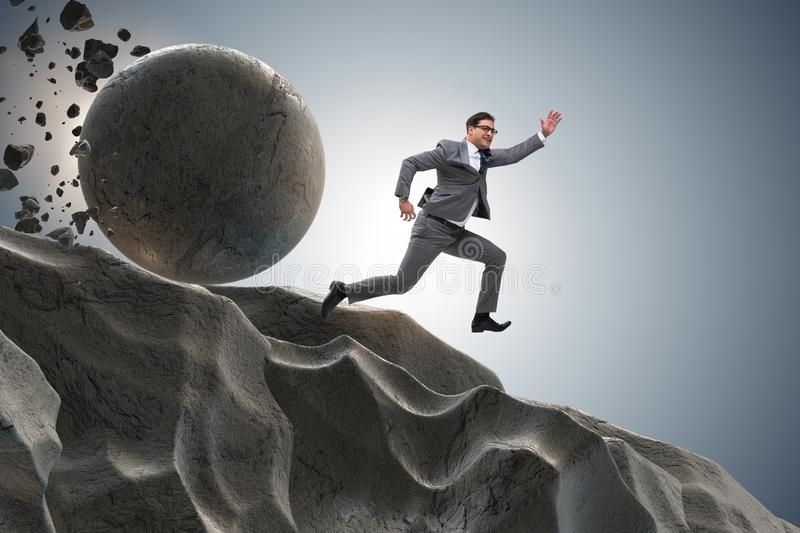 The businessman running away from falling rolling stone stock photos