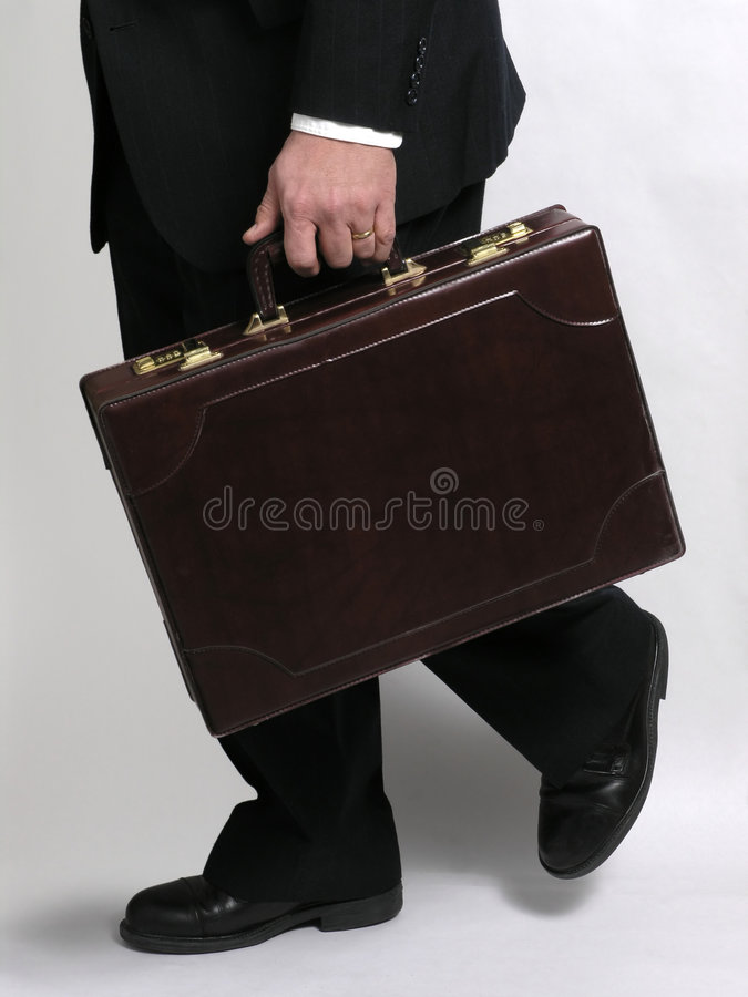 Businessman running with briefcase 1 stock photography