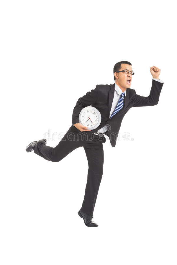Businessman running with clock. Business man running with clock stock photos