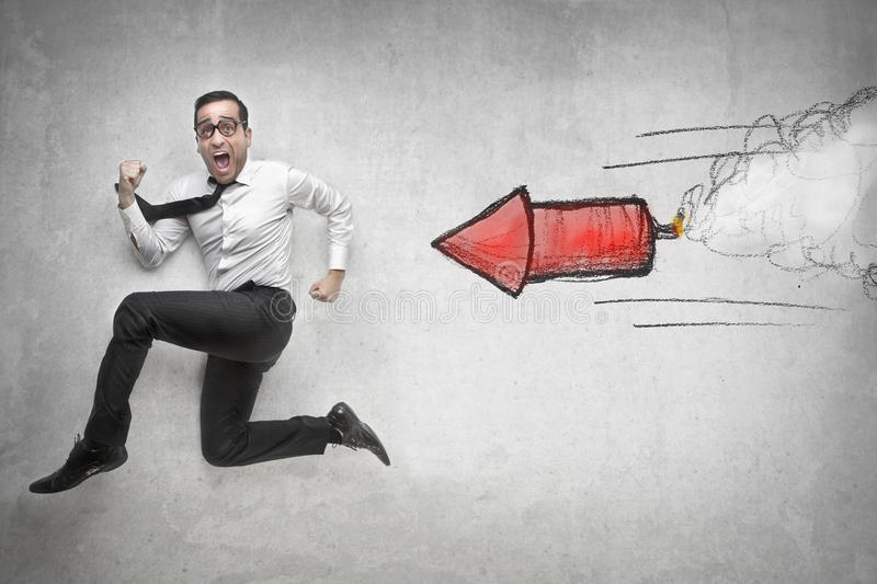Businessman running fast. Businessman running away while a flare is following him royalty free stock images