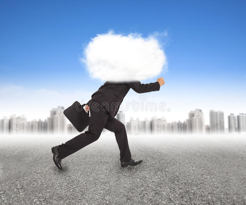 Businessman running with head in the clouds royalty free stock photos
