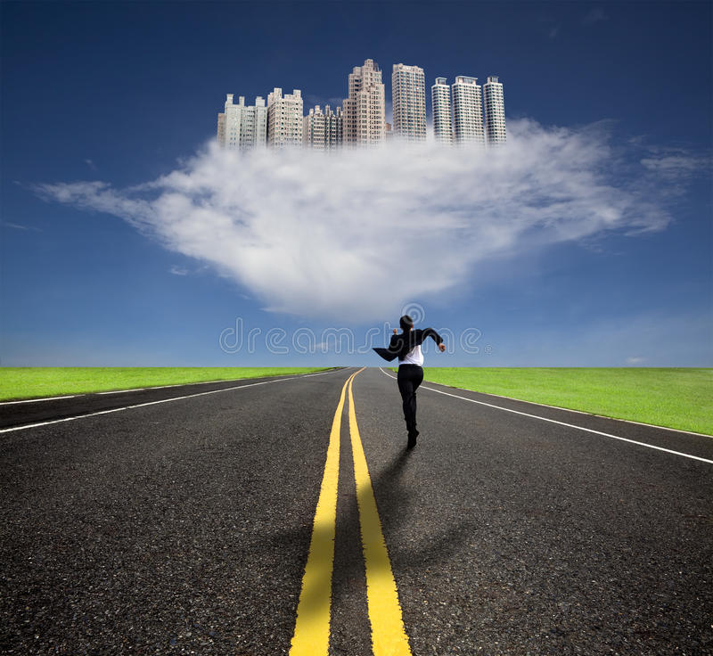 Businessman running to the future city. With his shadow royalty free stock images