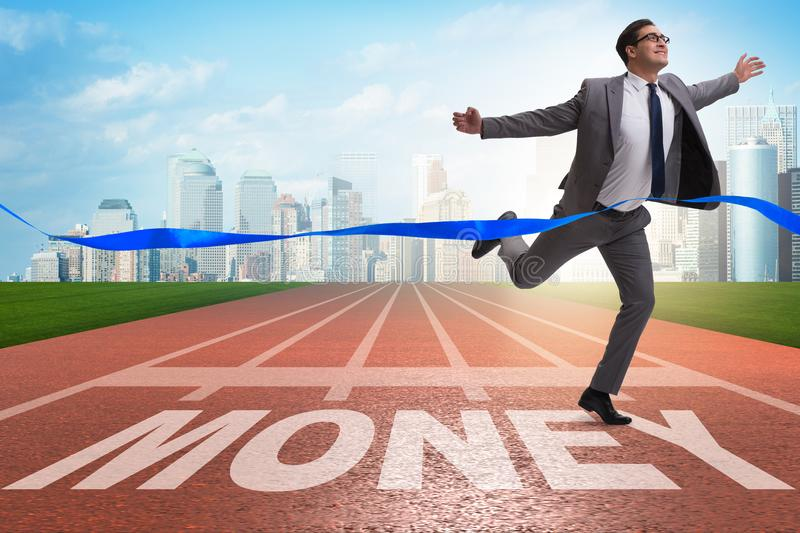 The businessman running towards money on track. Businessman running towards money on track royalty free stock photography