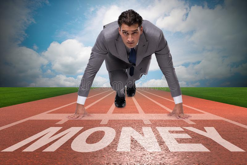The businessman running towards money on track royalty free stock photo