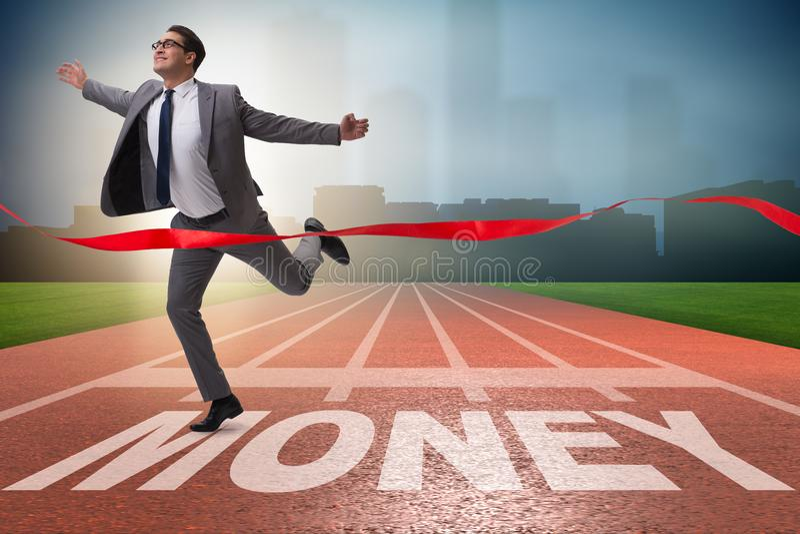 The businessman running towards money on track. Businessman running towards money on track royalty free stock photo