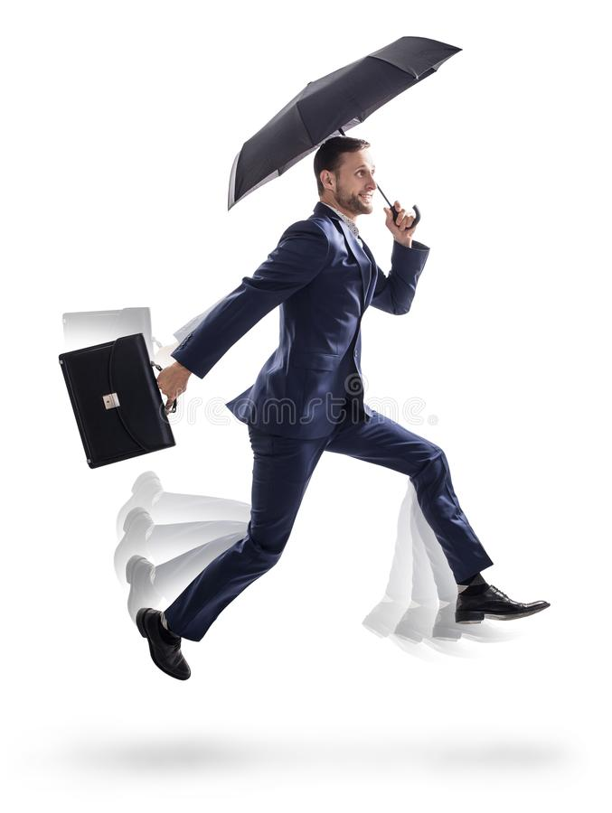 Businessman running with umbrella and briefcase. royalty free stock photos