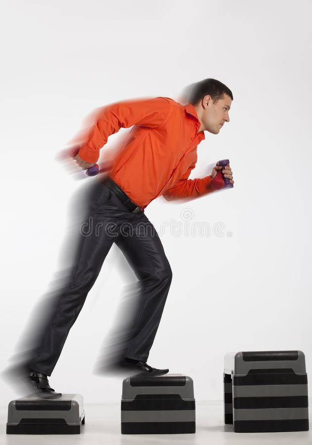 Businessman Running Up With Dumbbells Royalty Free Stock Photo