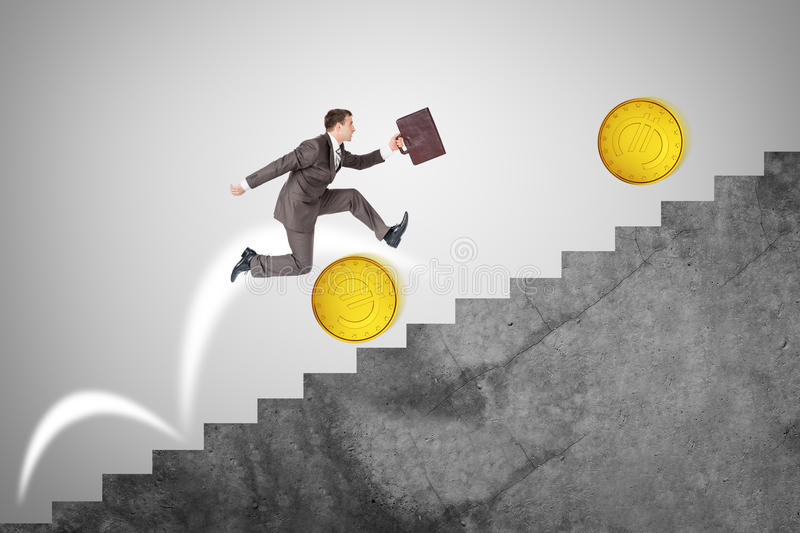 Businessman running up stairs, side view stock photo