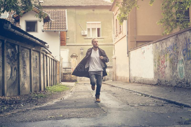 Businessman running. Young man running in the street. royalty free stock photo
