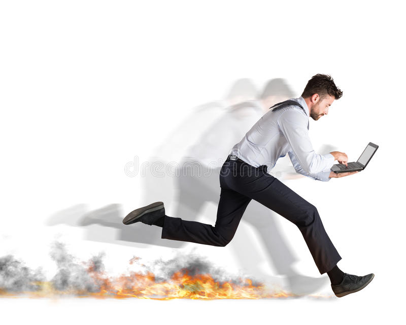 Fast business concept. Businessman runs quickly with laptop leaving fire trails. Fast business concept royalty free stock photo