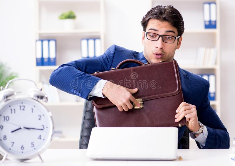 Businessman in rush trying to meet deadline royalty free stock photos
