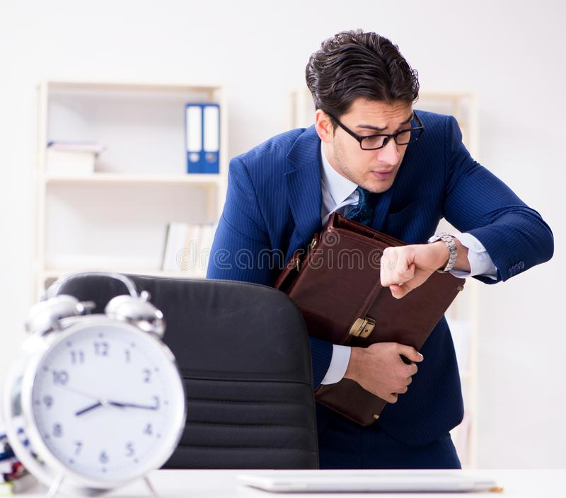 Businessman in rush trying to meet deadline stock photo