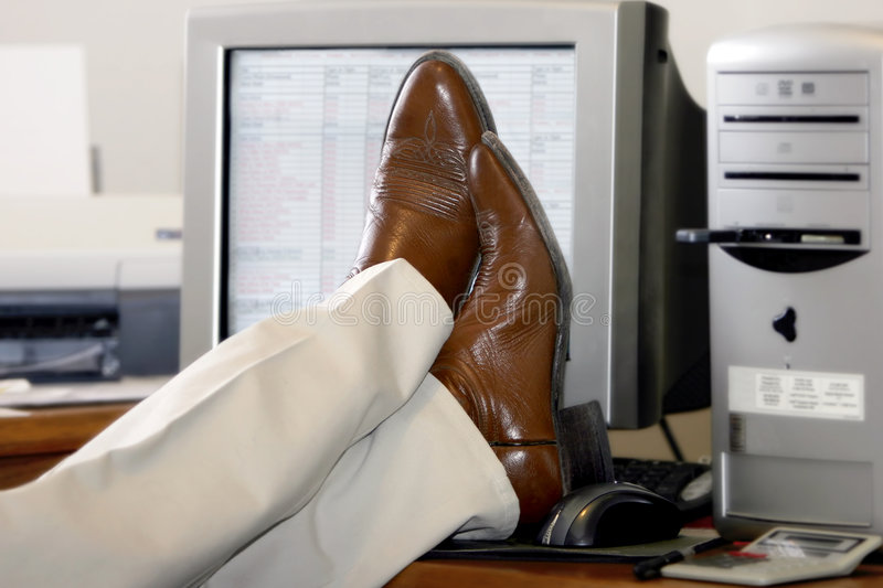 Download Businessman's Feet Propped Up On The Desk Stock Photo - Image: 592106
